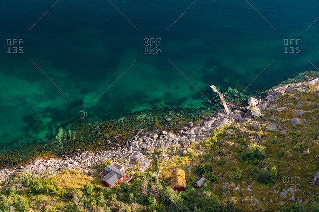 Aerial view over colourful sea & house, Henningsvaer, Austvagoy, Nordland