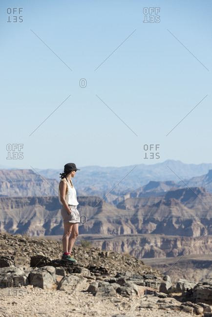 A woman stands on the edge of the Fish River Canyon in Namibia