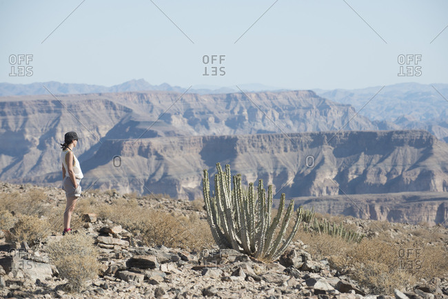 Woman looking in the Fish River Canyon in Namibia from the beginning of the hiking trail