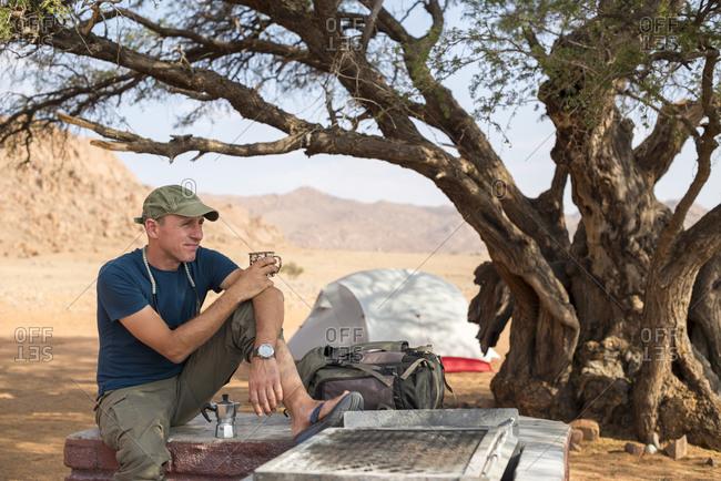 Man camping on the edge of the Namib desert