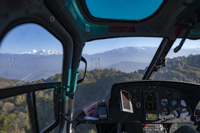 A helicopter in the Langtang region of the Himalayas with views of the Ganesh Himal range through the window