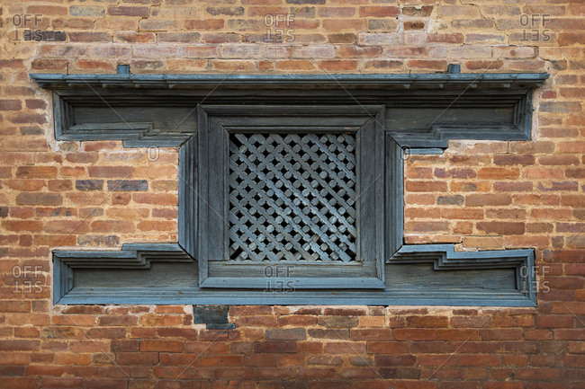 Traditional decorative Newari hand carved wood windows and architecture in an historical little village