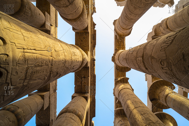 Pillars decorated with Hieroglyphics in the Great Hypostyle Hall of the ancient Karnak Temple in Luxor