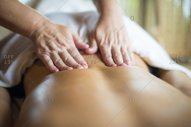 A woman being massaged