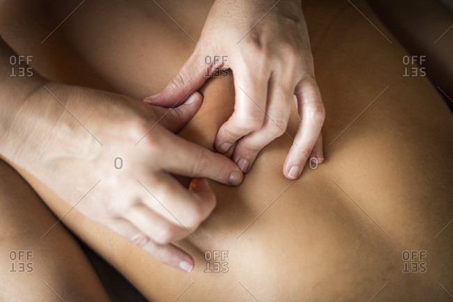 Overhead view of a woman being massaged