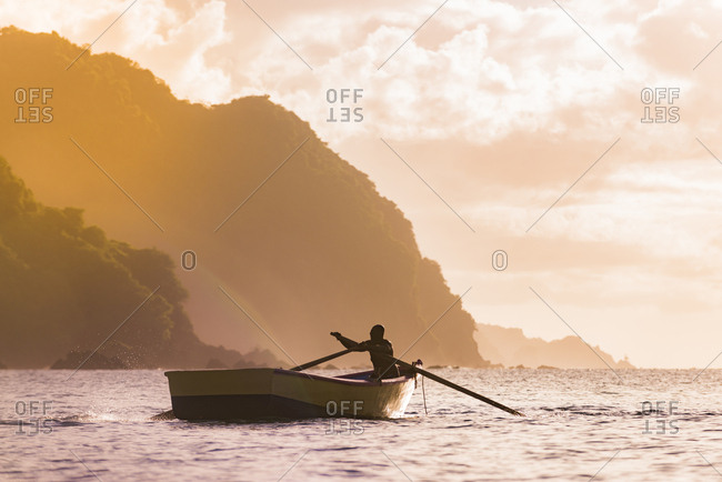 A man rowing a boat off the coast of Tobago