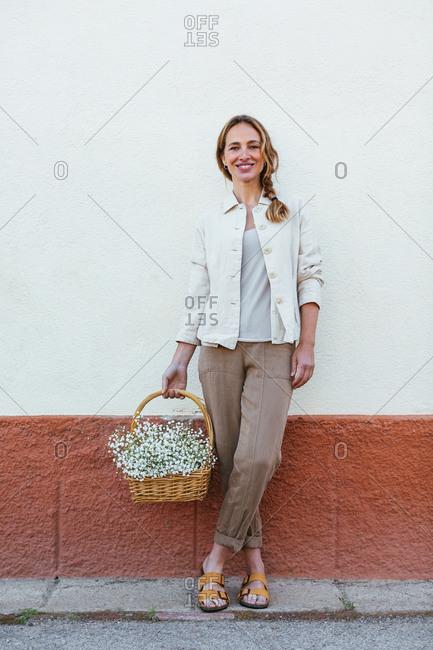 Portrait of a caucasian woman holding a flower's basket