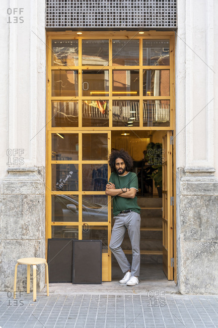 Portrait of a man standing at the entrance of a building