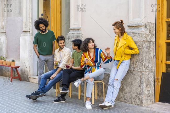 Group of friends having a break in the city