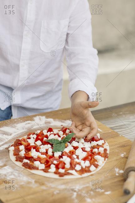 Boy preparing pizza