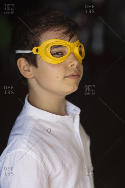 Boy wearing yellow eye mask- looking at camera