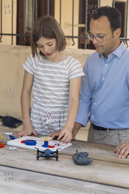 Father teaching his daughter electronics and robotics