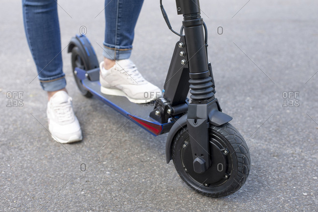 Woman with E-Scooter- partial view