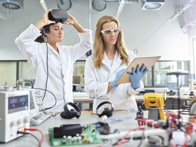 Female technicians working with tablet and vr glasses