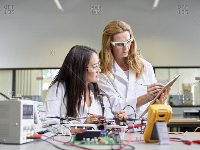 Female technicians working with tablet- testing drone