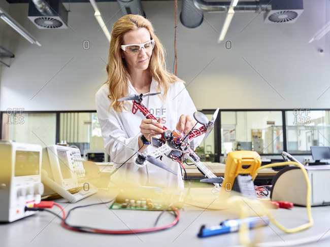 Female technician working in research laboratory- developing drone