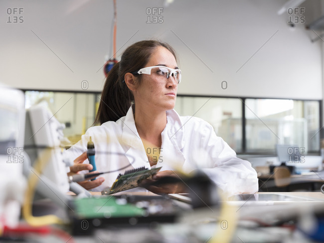 Female technician working in research laboratory