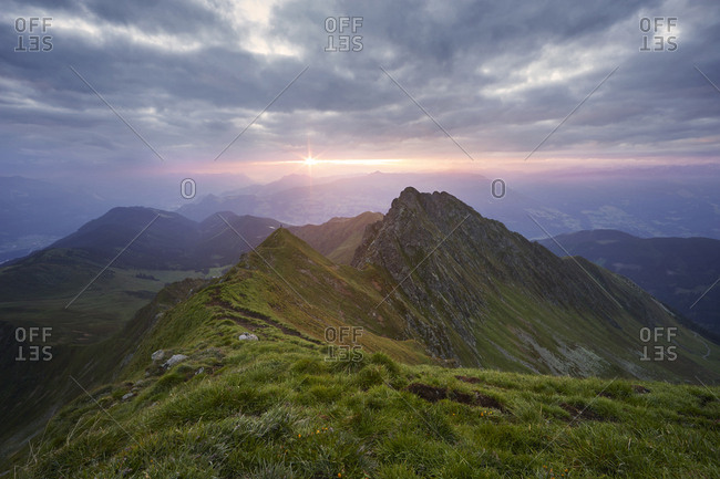 Austria- Tyrol- Inn Valley- Kellerjoch at sunrise- hiker on mountaintop