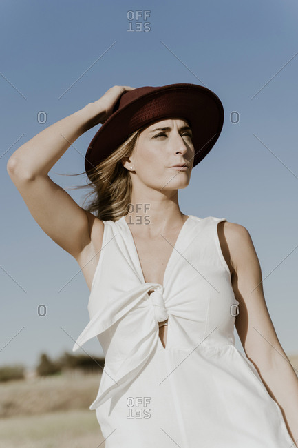 Portrait of female traveller with straw hat