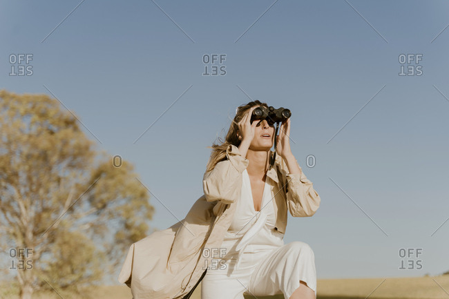 Female traveller looking through binoculars