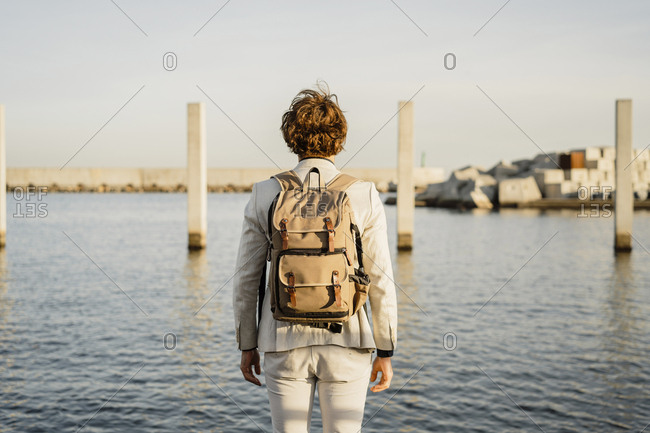 Back view of businessman with backpack looking at distance- Barcelona- Spain