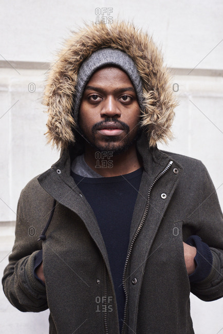 Portrait of mid adult man with hoodie in winter