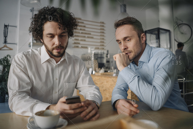 Two businessmen having a meeting in a coffee shop