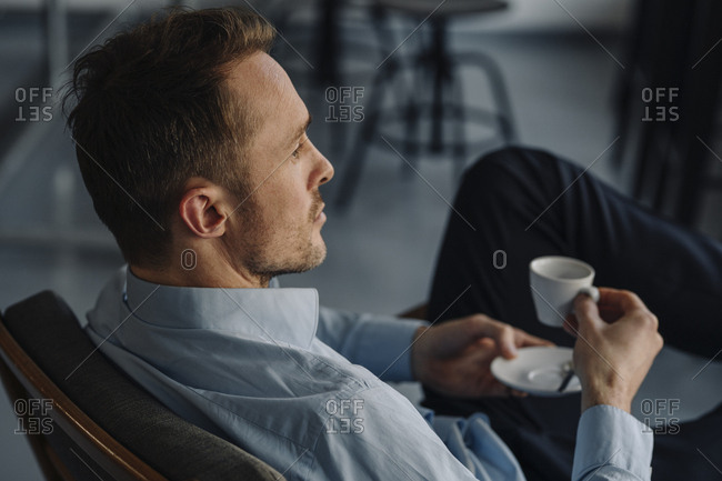 Successful businessman sitting in coffee shop