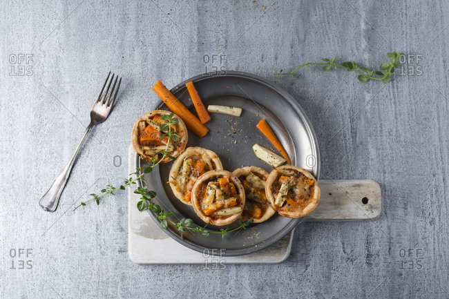 Pie with carrots and parsnip on tin plate