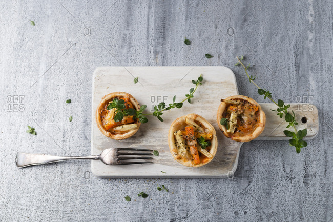 Pie with carrots and parsnip on wooden board