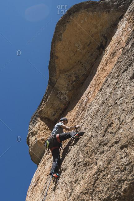Man climbing in rock wall
