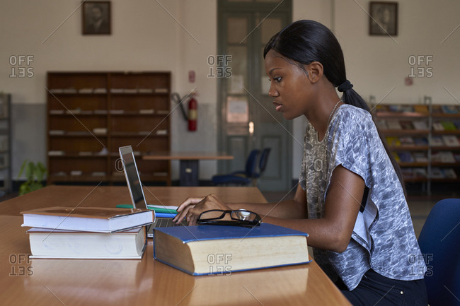 Young student working on laptop at National library- Maputo- Mocambique