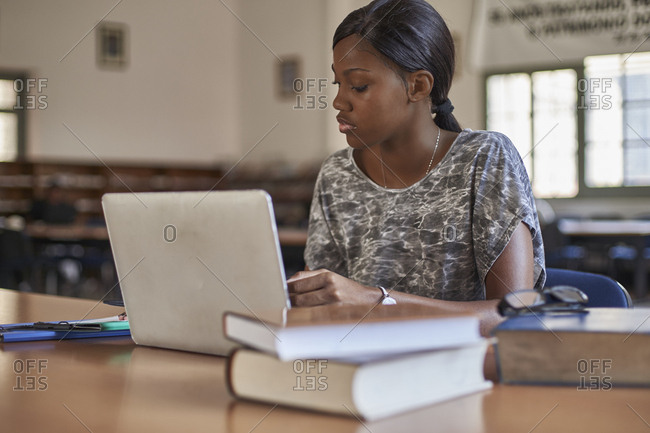 Young student working with laptop at National library- Maputo- Mocambique