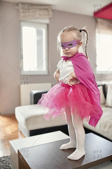 Girl wearing costume of a superwoman