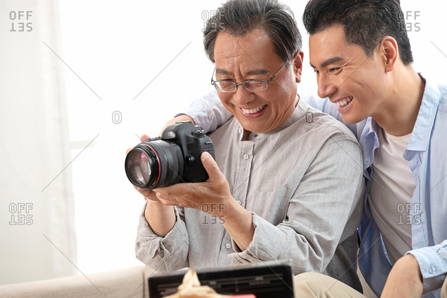 Happy father and son to see the camera