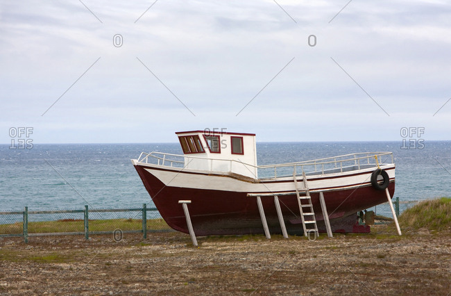 Fishing boat up on land in Nova Scotia, Canada