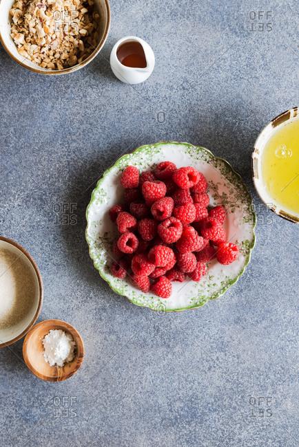 Raspberries, sugar, egg whites, nuts, vinegar and cornstarch. Ingredients for Pavlova cake, meringue roll. Top view
