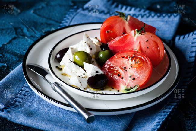 Breakfast with heirloom tomatoes, feta cheese, olives. Served with crusty multigrain bread.