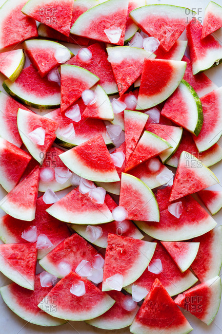 Watermelon slices kept cold with ice cubes
