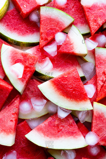Close up of watermelon slices kept cold with ice cubes