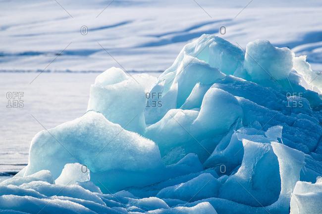 Blue glacial iceberg detail in Svalbard