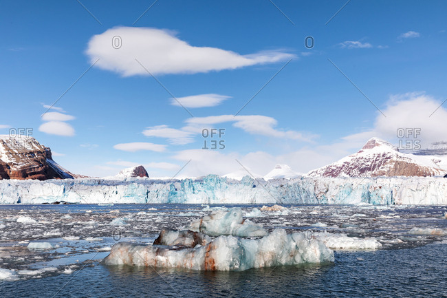 Glacier, icebergs and the Three Crown mountains of Kongsfjorden, Svalbard