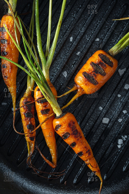 Carrots cooked in a pan grill top view