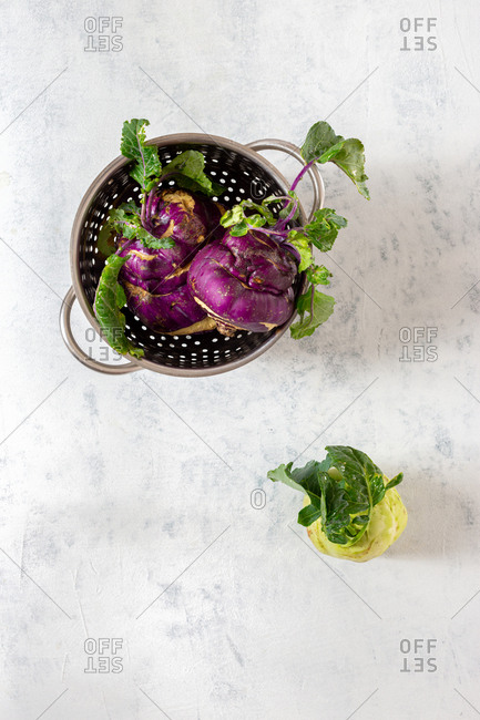 Kohlrabi cabbage on white background. Cooking healthy food concept