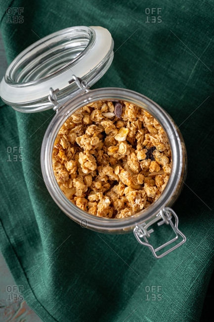 Crunchy granola in jar top view