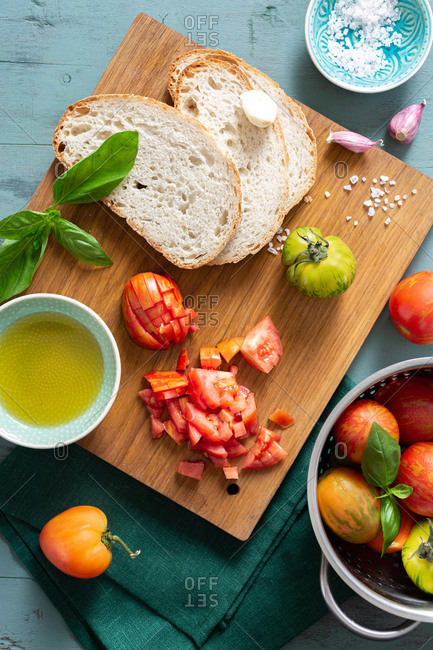 Ingredients for cooking bruschetta with with tomato, olive oil and basil
