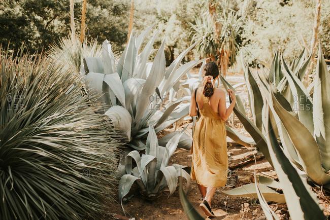 Woman walking through botanical garden, Dubrovnik, Croatia
