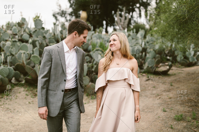 Nicely dressed couple walking in the desert