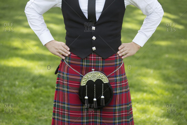 Young man in traditional kilt at a dance competition at Prince's park, Edinburgh, Scotland