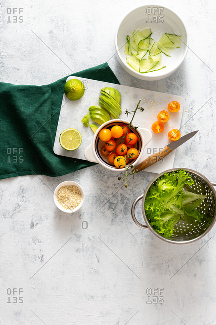 Cooking diet salad on a white background top view